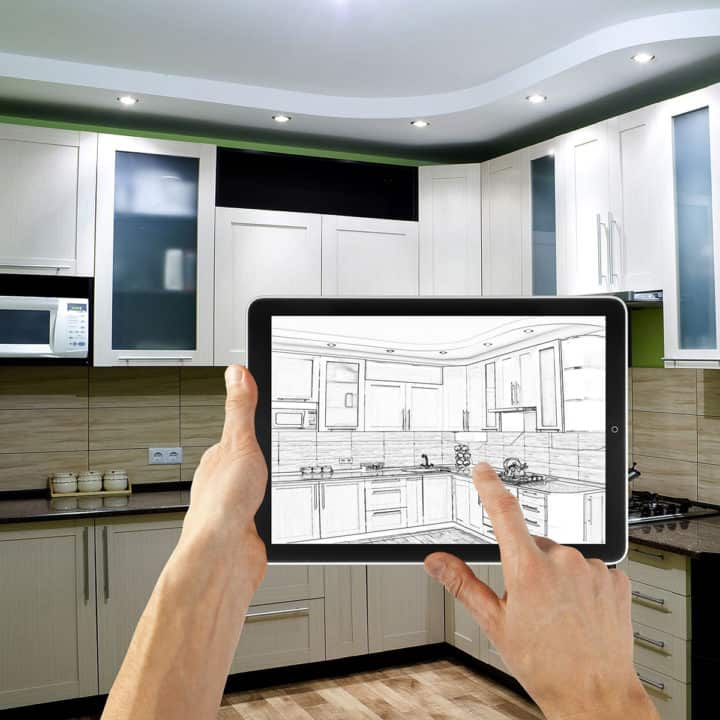 kitchen design on ipad in front of real kitchen