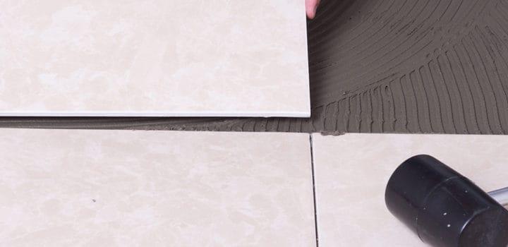 Tiler installing ceramic floor tile