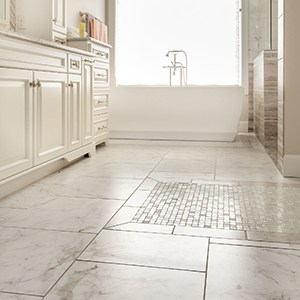 ceramic floor tile in multiple sizes laid across a large bathroom