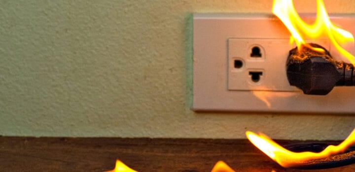 electric wall plug on fire