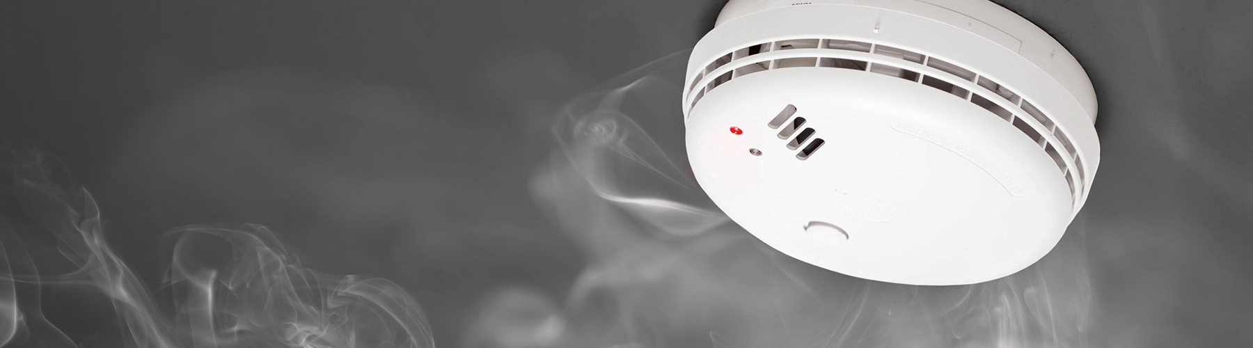 fire safety - smoke alarm detecting white smoke