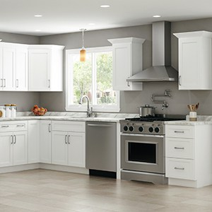 white kitchen cabinets with stainless steel appliances and a laminate countertop