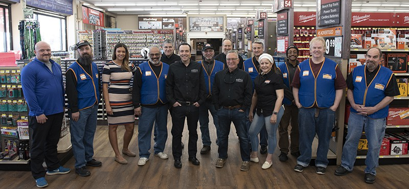 Norfolk hardware employees posing for a picture inside of the hardware store