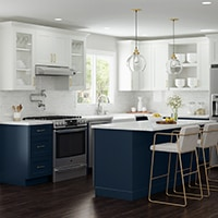 white and blue kitchen cabinets with island, open shelving and stove