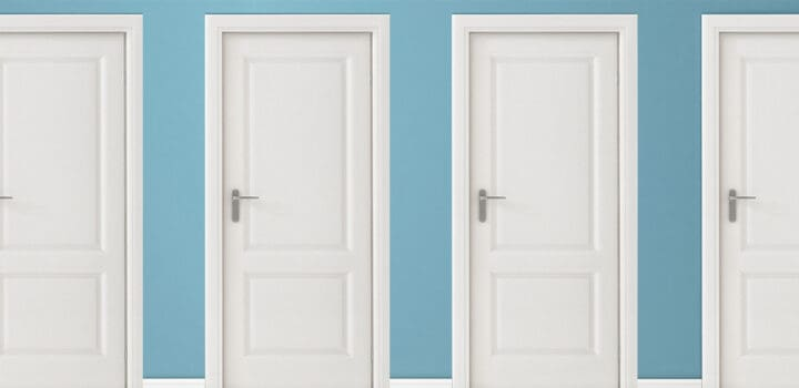 4 white interior doors on a blue wall